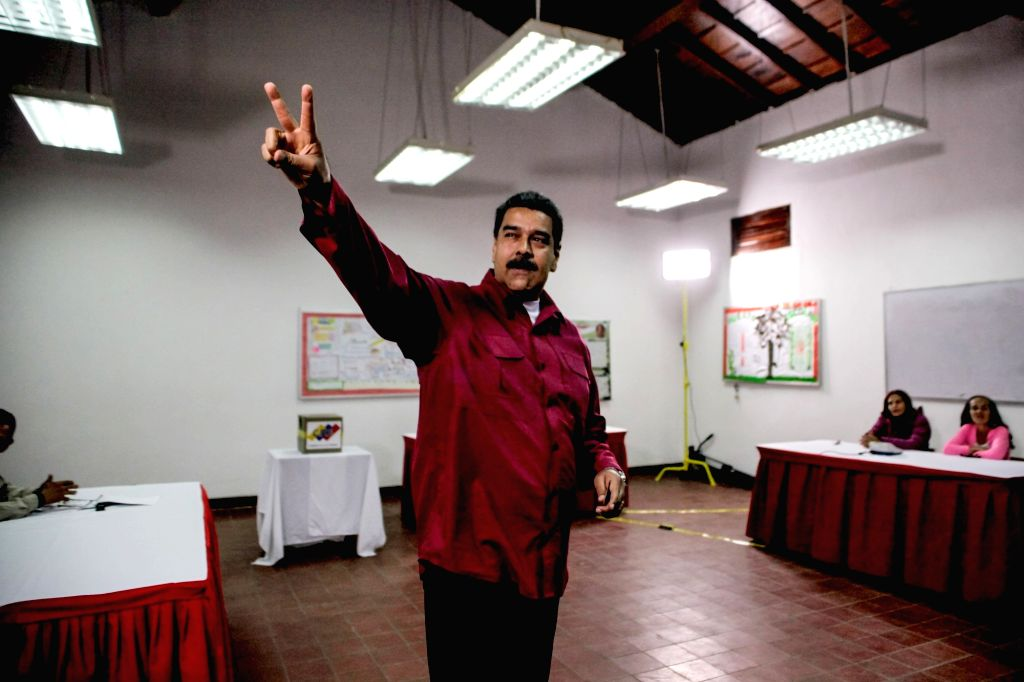 CARACAS, May 20, 2018 - Venezuelan President Nicolas Maduro waves after casting his vote during the presidential elections in Caracas, Venezuela, on May 20, 2018