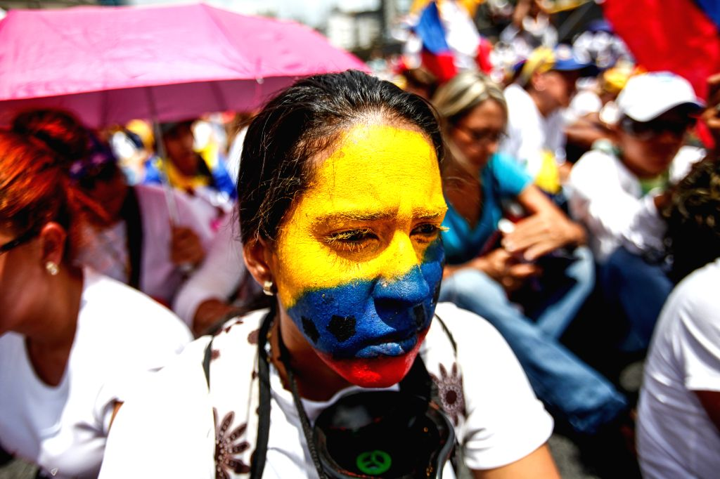 CARACAS, May 7, 2017 - A demonstrator takes part in a rally organized by female supporters of the opposition in Caracas, Venezuela, on May 6, 2017. Female supporters of both the government and the ...