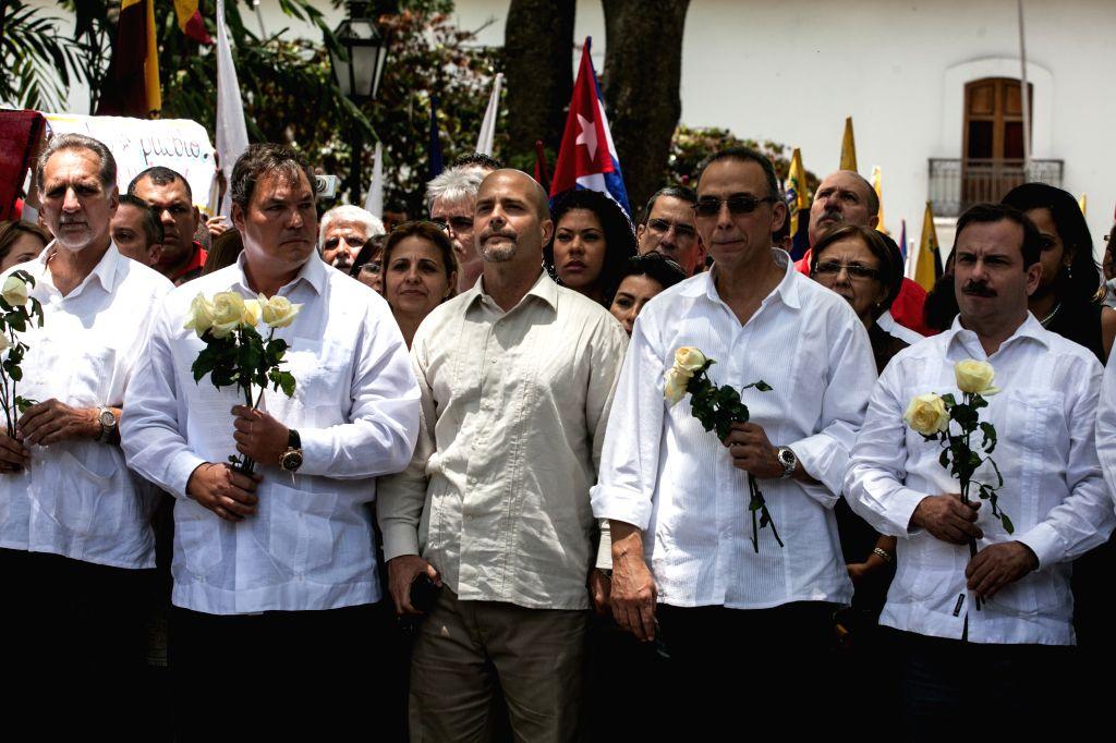 "(From L to R) Rene Gonzalez, Ramon Labanino, Gerardo Hernandez, Antonio Guerrero and Fernando Gonzalez, members of ""Cuban Five"" react after receiving the ..."