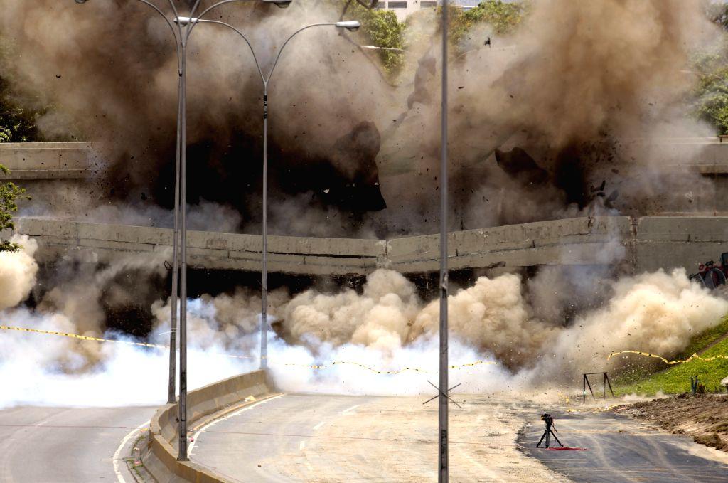 The Santa Cecilia Bridge is demolished in a controlled explosion on the Francisco Fajardo Highway in Caracas, capital of Venezuela, Sept. 7, 2014. (Xinhua/Adreina ..
