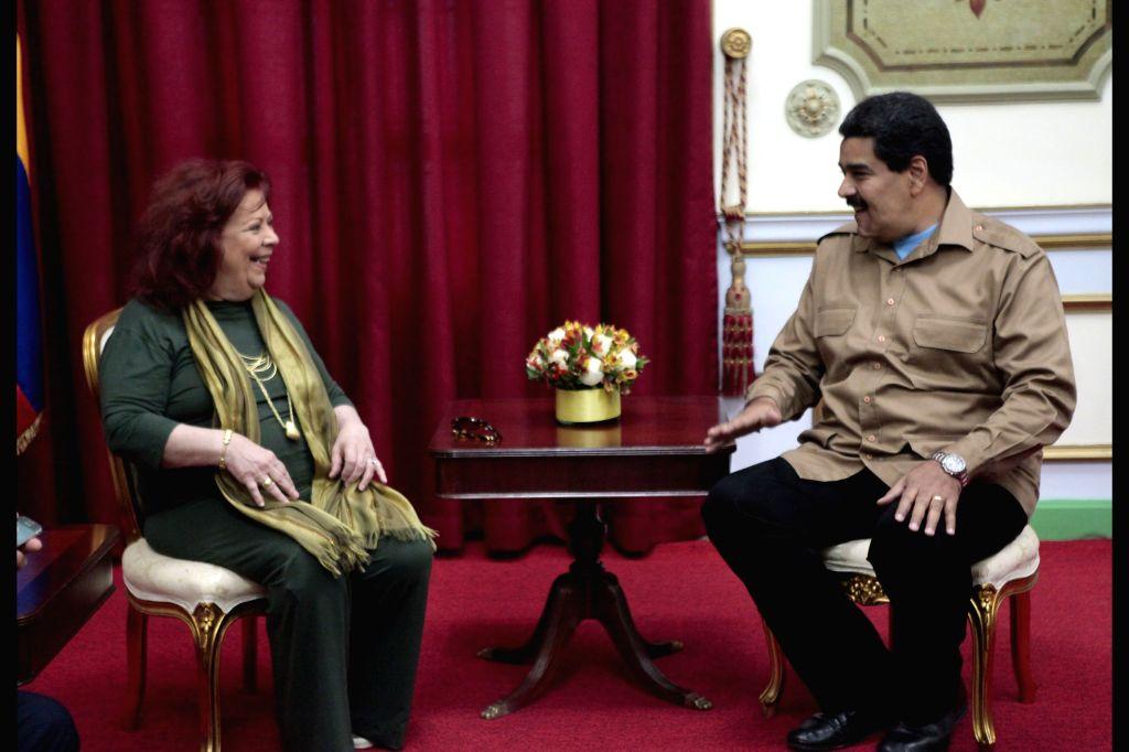 Venezuela's President Nicolas Maduro (R) meets with Brazilan singer Beth Carvalho at Miraflores Palace in Caracas, Venezuela, Sept. 8, 2014. (Xinhua/Ricardo ...