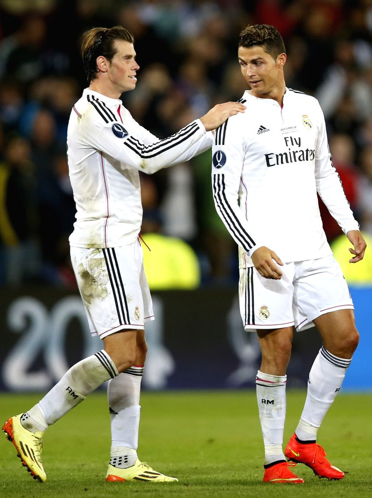 Gareth Bale(L) Real Madrid celebrates with Cristiano Ronaldo after the UEFA Super Cup match between Real Madrid and Sevilla at Cardiff City Stadium in Cardiff, ...