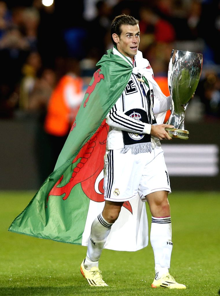 Real Madrid's Gareth Bale celebrates with the trophy after the UEFA Super Cup match between Real Madrid and Sevilla at Cardiff City Stadium in Cardiff, Britain on ..