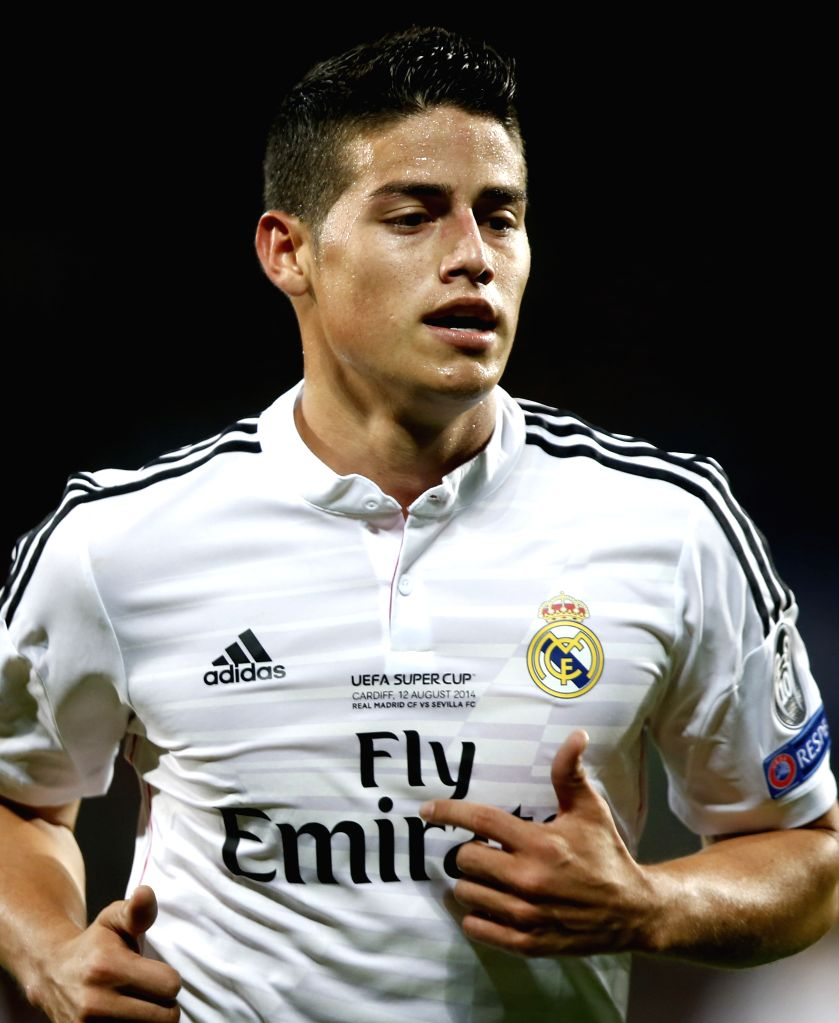 Real Madrid's James Rodriguez looks on during the UEFA Super Cup match between Real Madrid and Sevilla at Cardiff City Stadium in Cardiff, Britain on Aug. 12, 2014.