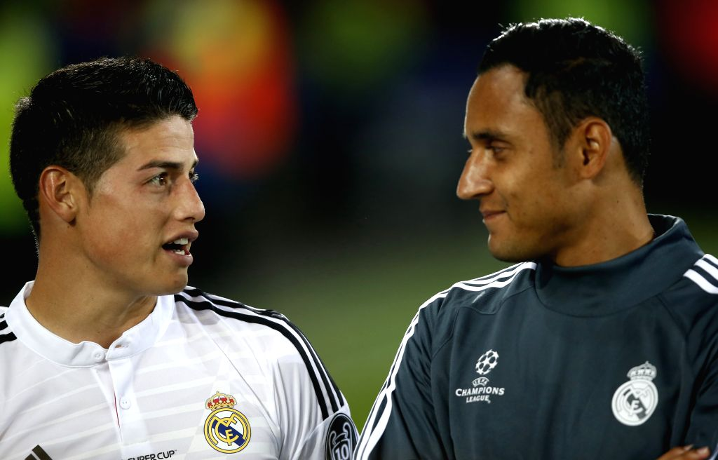 Real Madrid's James Rodriguez(L) communicates with his teammate Keylor Navas from Costa Rica after the UEFA Super Cup match between Real Madrid and Sevilla at ...