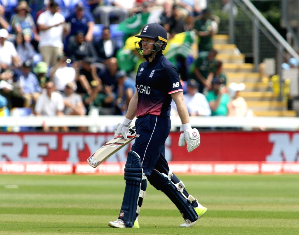 Cardiff: Eoin Morgan of England walks back to the pavilion after getting dismissed during the first Semi-final match of ICC Champions Trophy between England and Pakistan at Sophia Gardens in Cardiff, Wales, Britain onJune 14, 2017. (Photo: Surjeet Ya - Surjeet Yadav