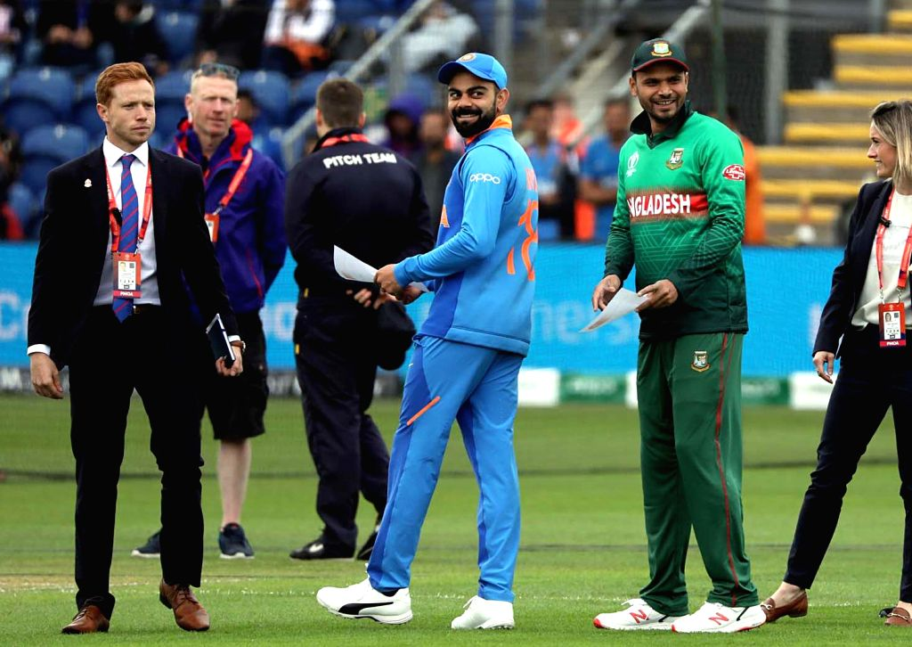 Cardiff: India's skipper Virat Kohli and Bangladesh's skipper Mashrafe Mortaza during the toss ahead of the second warm-up match between India and Bangladesh at the Sophia Gardens in Cardiff, Wales on May 28, 2019. (Photo: IANS) - Virat Kohli