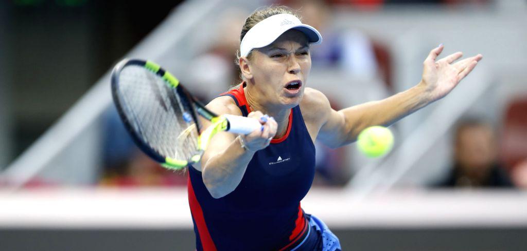 :Caroline Wozniacki of Denmark hits a return during the women's singles final against Anastasija Sevastova of Latvia at the China Open tennis tournament in ...