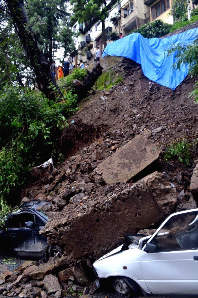 Cars buried under debris after a landslide struck Shimla on July 24, 2018.
