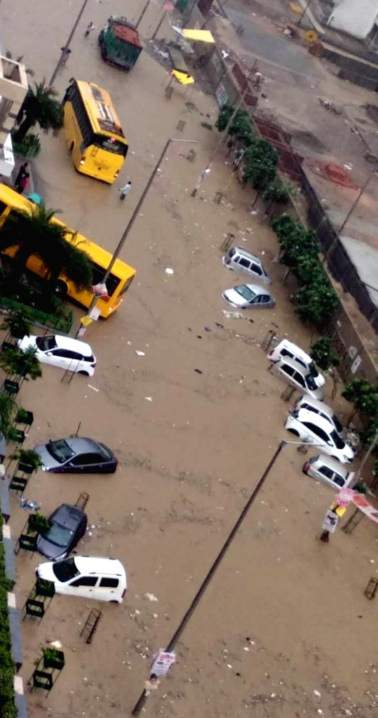 Cars stranded in flood water due to heavy rains, in New Delhi, on July 27, 2018.