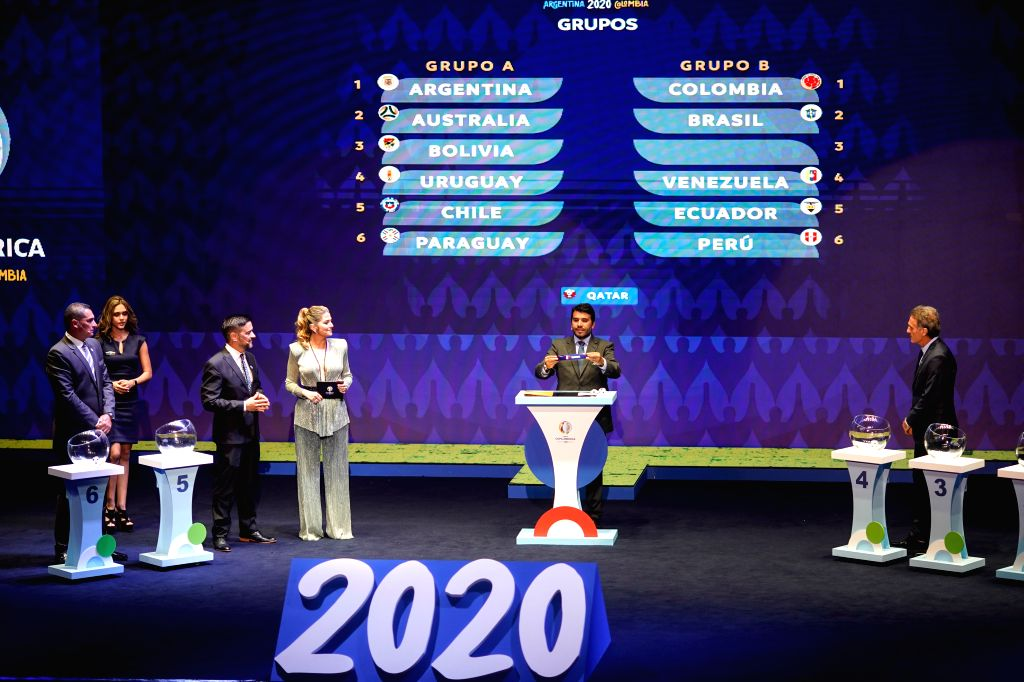 CARTAGENA, Dec. 4, 2019 - Hugo Figueredo (2nd R), competition director of the Conmebol(the South American Football Confederation), holds up the team name of Qatar during the draw for the 2020 Copa ...