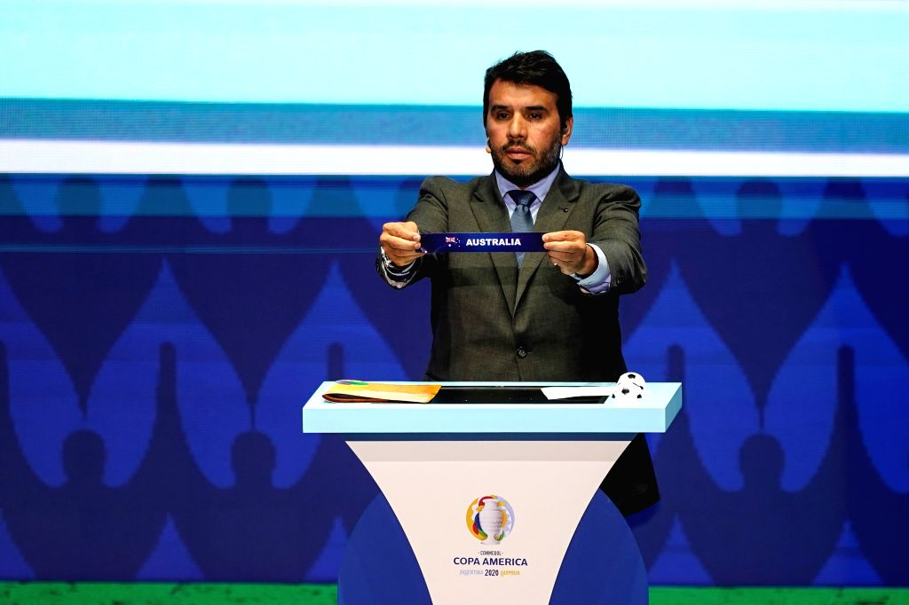 CARTAGENA, Dec. 4, 2019 - Hugo Figueredo, competition director of the Conmebol(the South American Football Confederation), holds up the team name of Australia during the draw for the 2020 Copa ...