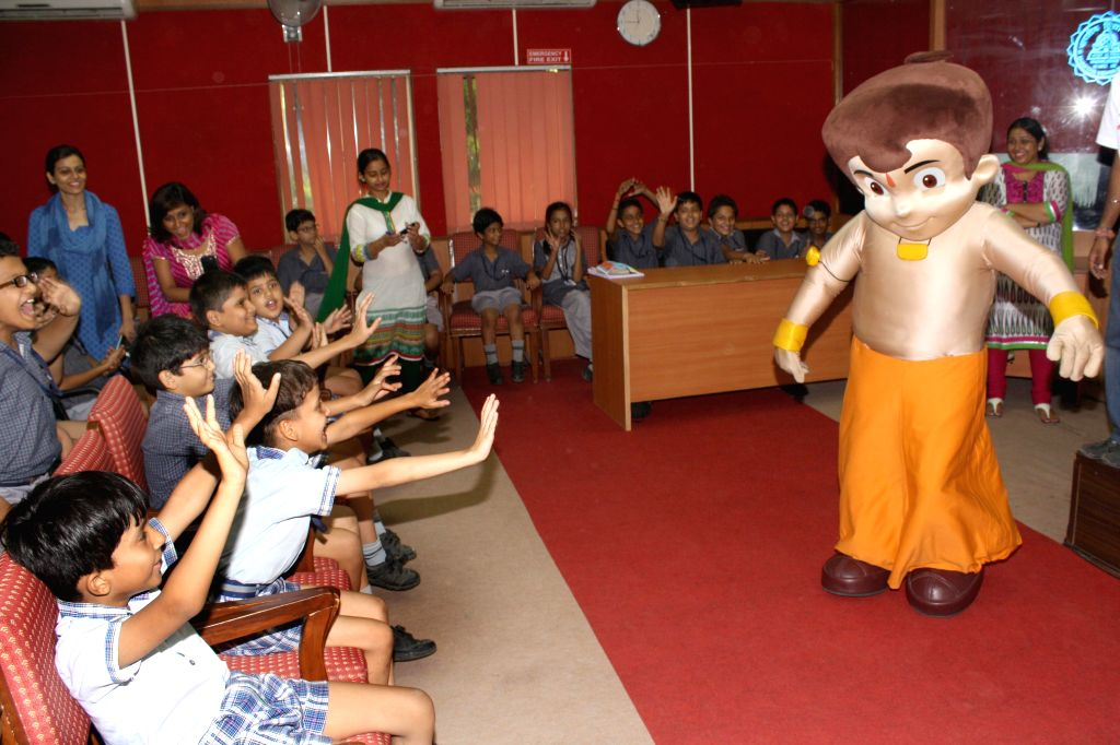 Cartoon character of an Indian animated comedy-adventure series, Chhota Bheem with students of a Delhi school in New Delhi on Sept 8, 2014.