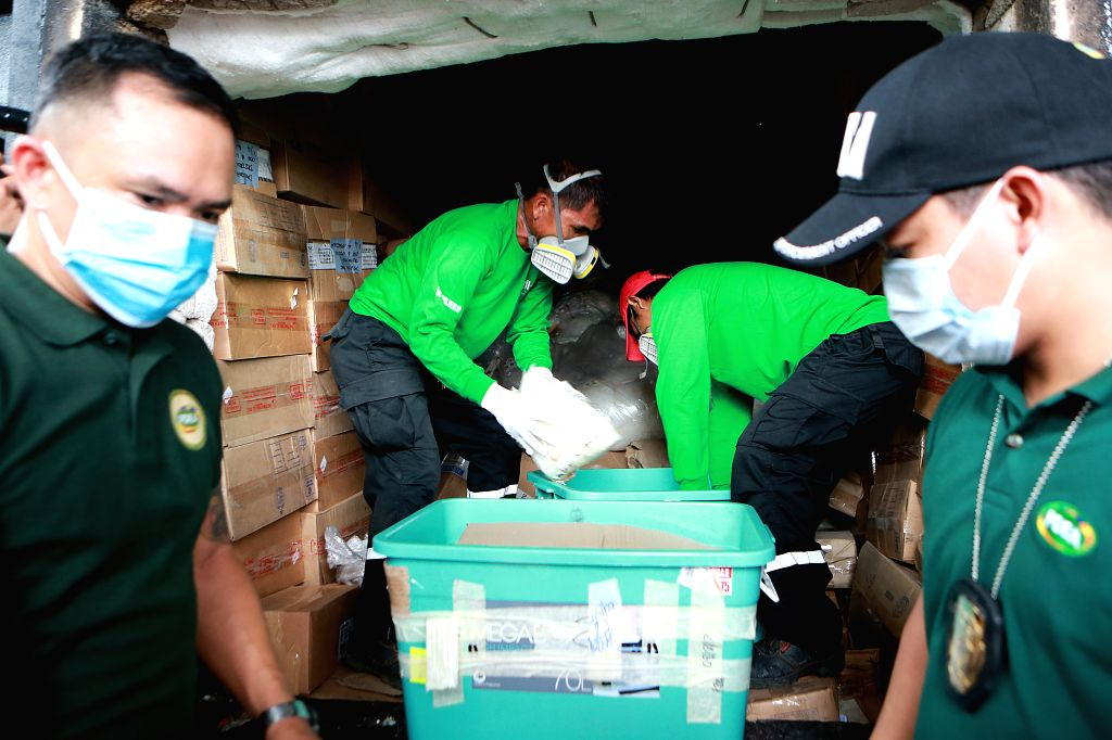 CAVITE, July 27, 2018 - Agents from the Philippine Drug Enforcement Agency (PDEA) and workers load confiscated illegal drugs into an incinerator during the destruction of illegal drugs in Cavite ...