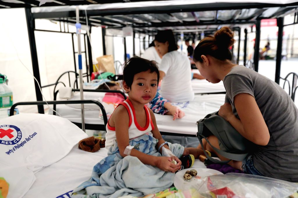 CAVITE PROVINCE, Aug. 13, 2019 - Dengue patients rest at a Dengue Emergency Medical Unit set up by the Philippine Red Cross in Cavite Province, the Philippines, Aug. 13, 2019. On Aug. 6, the ...
