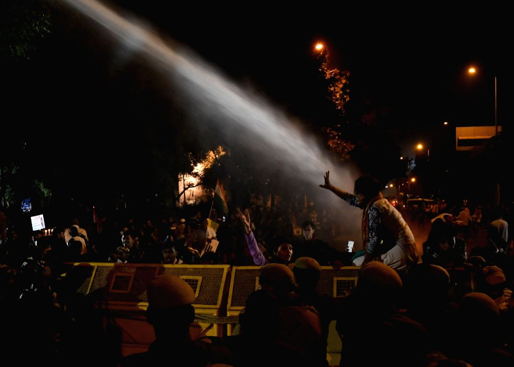 ccPolice charges Delhi Commission for Women (DCW) members with water canons during their candlelight vigil to express solidarity with rape victims and to oppose rising incidents of crimes ...