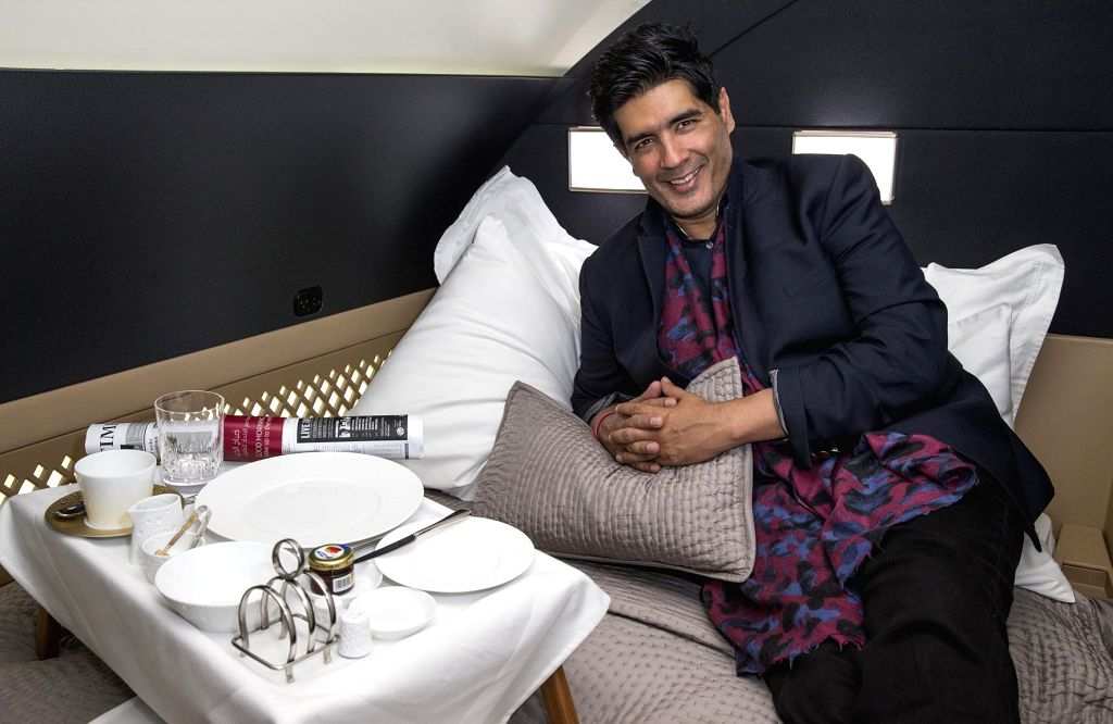 Celebrated Indian fashion couturier Manish Malhotra is pictured in a mock-up of Etihad Airways? award-winning three-room cabin ? The Residence ?  during his visit to the airline?s Innovation Centre ... - Manish Malhotra