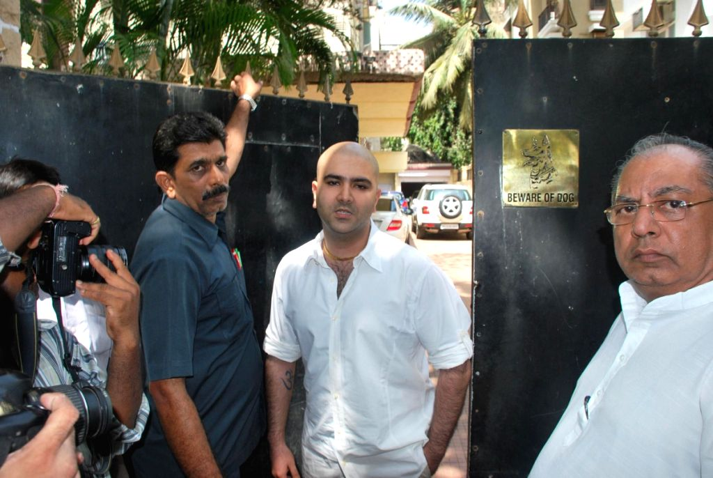 Celebraties outside filmmaker Prakash Mehra's residence. Mehra passed away Sunday morning.