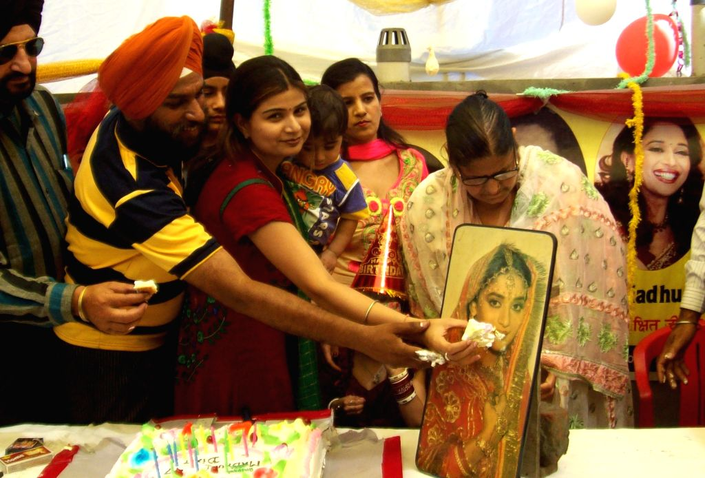 Celebrations on the eve of actress Madhuri Dixit's birthday in Amritsar on May 14, 2014.