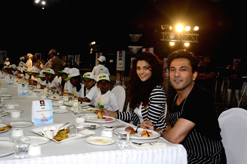 Celebrity Chef Vikas Khanna and actress Saiyami Kher during the launch of 'Quaker Feed a Child' on the occasion of World Food Day in Mumbai. - Saiyami Kher and Chef Vikas Khanna