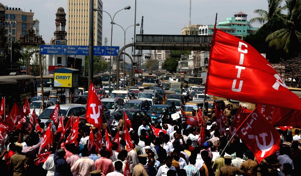 Centre of Indian Trade Unions (CITU) workers block roads as they stage a demonstration during a DMK-led shutdown strike over the Centre's failure to set up a Cauvery Management Board (CMB), ...
