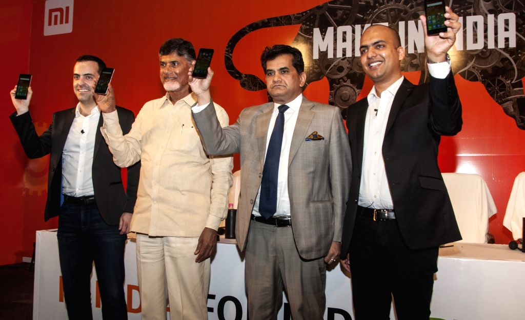 CEO Xiaomi India Manu Jain, Andhra Pradesh Chief Minister N. Chandrababu, Secretary department of industrial policy Amitabh Kant and VP Global Xiaomi Hugo Barra during the announcement ... - N. Chandrababu and Manu Jain