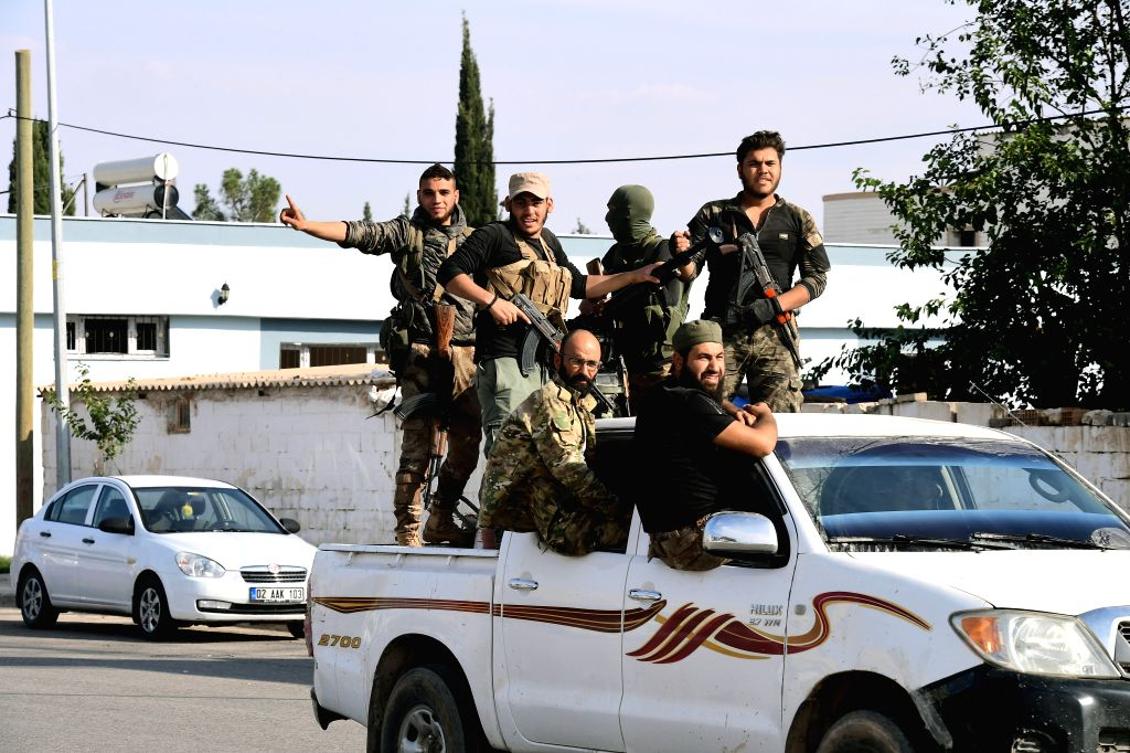 CEYLANPINAR (TURKEY), Oct. 23, 2019 (Xinhua) -- Members of Syrian rebel groups allied with Turkey are seen in the Turkish border town of Ceylanpinar, on their way to northern Syrian town of Ras al-Ayn, on Oct. 23, 2019. Turkish Defense Ministry said