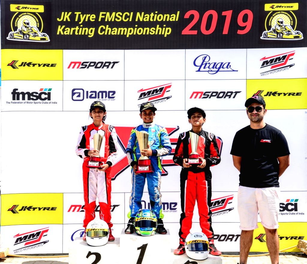 Chaggalagatti: Gold medal winner Ishaan Madhesh (C) with silver medalist Shriya Lohia (L) and bronze medalist Sai Shiva Makesh Sankaran (R) after winning gold medal in Cadet category during FMSCI National Karting Championship at the podium at the Mec