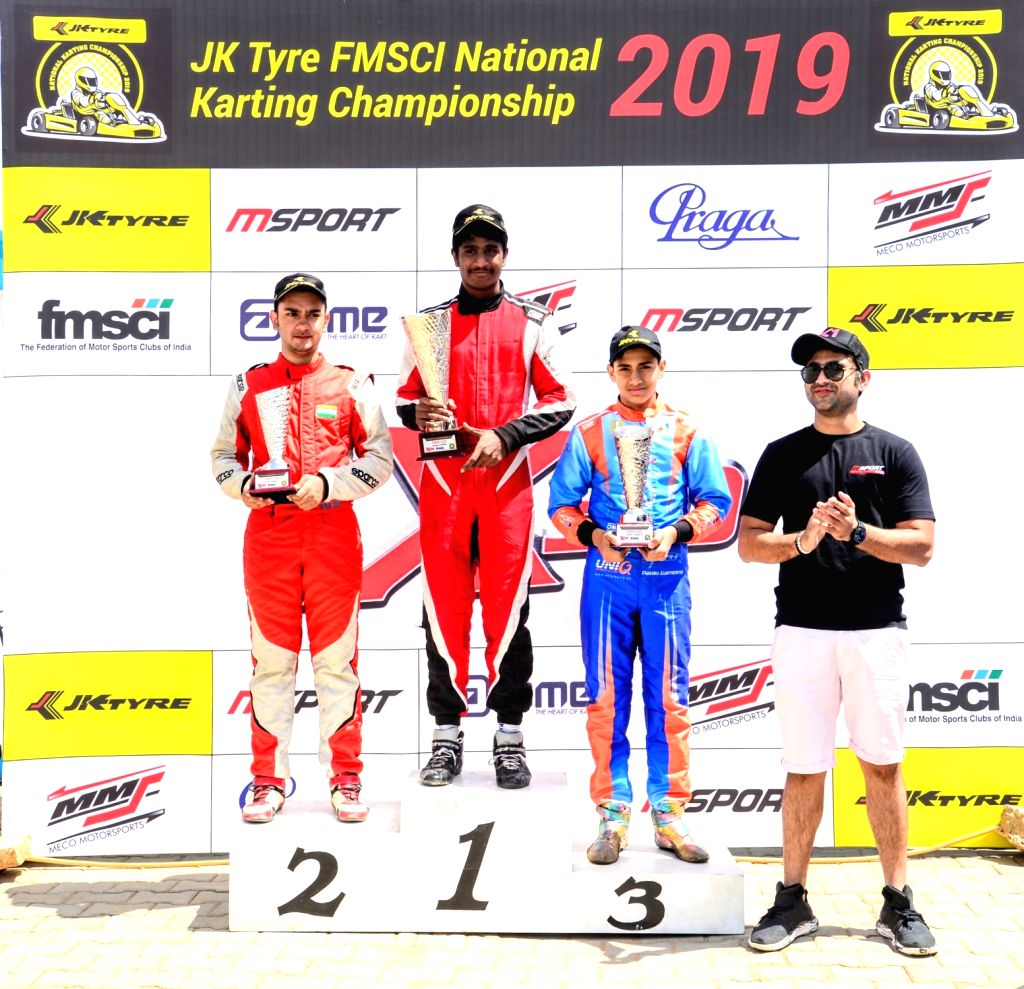 Chaggalagatti: Gold medal winner Nirmal Umashankar (C) with silver medalist Debarun Banerjee (L) and bronze medalist Shahan Ali Mohsin (R) after winning gold medal in Senior category during FMSCI National Karting Championship at the podium at the Mec - Debarun Banerjee