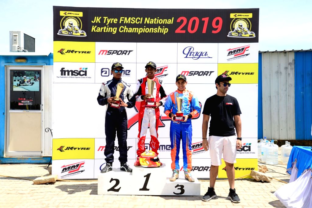 Chaggalagatti: Gold medal winner Ruhaan Alva (C) with silver medalist Arun S. Nair (L) and bronze medalist Shahan Ali Mohsin (R) after winning gold medal in Junior category during FMSCI National Karting Championship at the podium at the Meco Kartopia