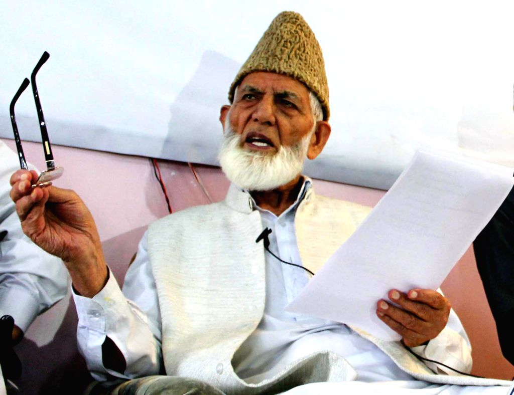 Chairman All Parties Hurriyat Conference Syed Ali Shah Geelani addressing a press conference at Hyderpora in Srinagar on Aug. 9, 2014.