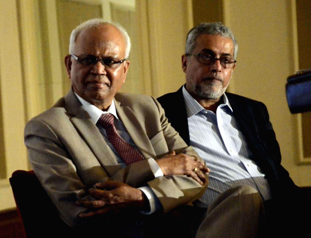 Chairman of Gen Next Ventures, Dr R A Mashelkar with the chairman of Microsoft Corporation (India) Pvt. Ltd, Bhaskar Pramanik during a programme in Mumbai on Sept 5, 2014.
