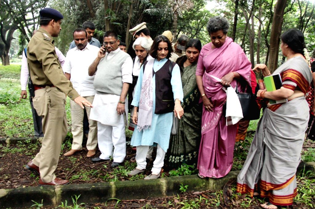 Chairman of the expert committee on prevention of crimes against women and children, V S Ugrappa inspects the spot where two security guards allegedly gang-raped a 30-year-old woman, at ...