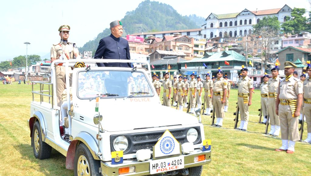 Himachal Pradesh Chief Minister Virbhadra Singh inspects guard of honour during the  Himachal Day function organised at Chamba on April 15, 2015.