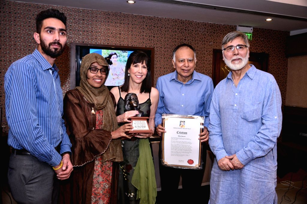 Chandigarh: Author Wendy Sue Knecht confers Neerja Bhanot Award on young braveheart from Kerala, Sifiya Haneef in Chandigarh on Sep 7, 2019. The Neerja Bhanot Award was instituted in 1990 in memory of Neerja Bhanot, who saved hundreds of lives while
