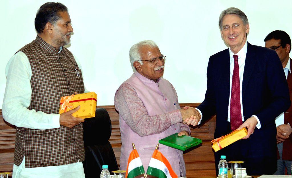 British Foreign Secretary Philip Hammond calls on Haryana Chief Minister Manohar Lal Khattar in Chandigarh on March 11, 2015. Also seen Haryana Education Minister Ram Bilas Sharma. - Manohar Lal Khattar and Bilas Sharma