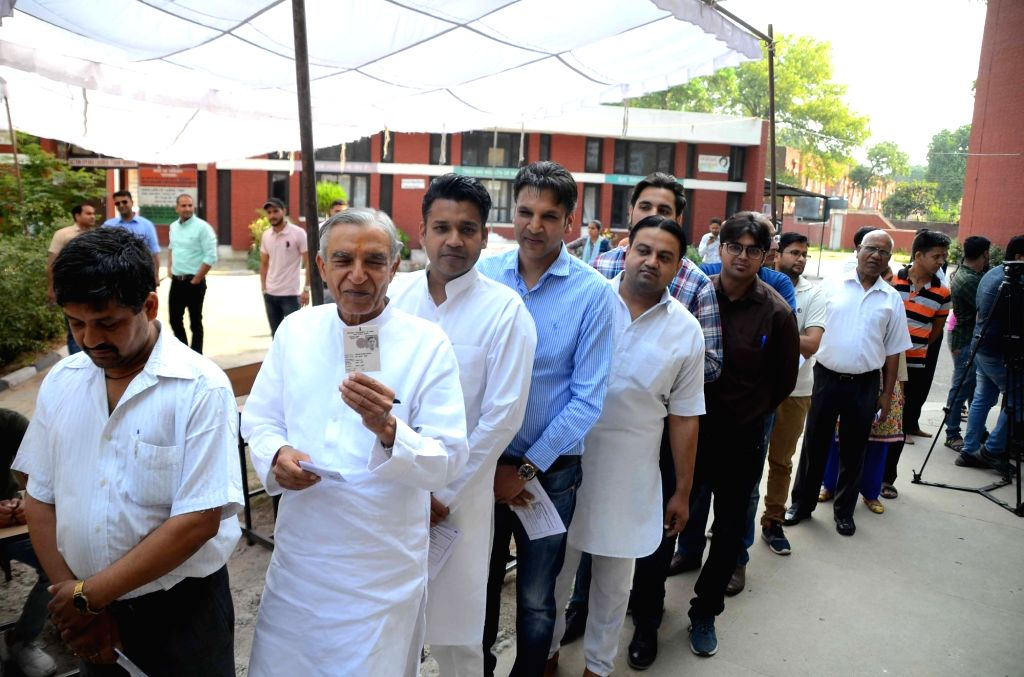 Chandigarh: Congress leader Pawan Bansal waits for his turn as he stands in a queue to cast his vote during the seventh and the last phase of 2019 Lok Sabha Elections at a polling booth in Chandigarh on May 19, 2019. (Photo: IANS)