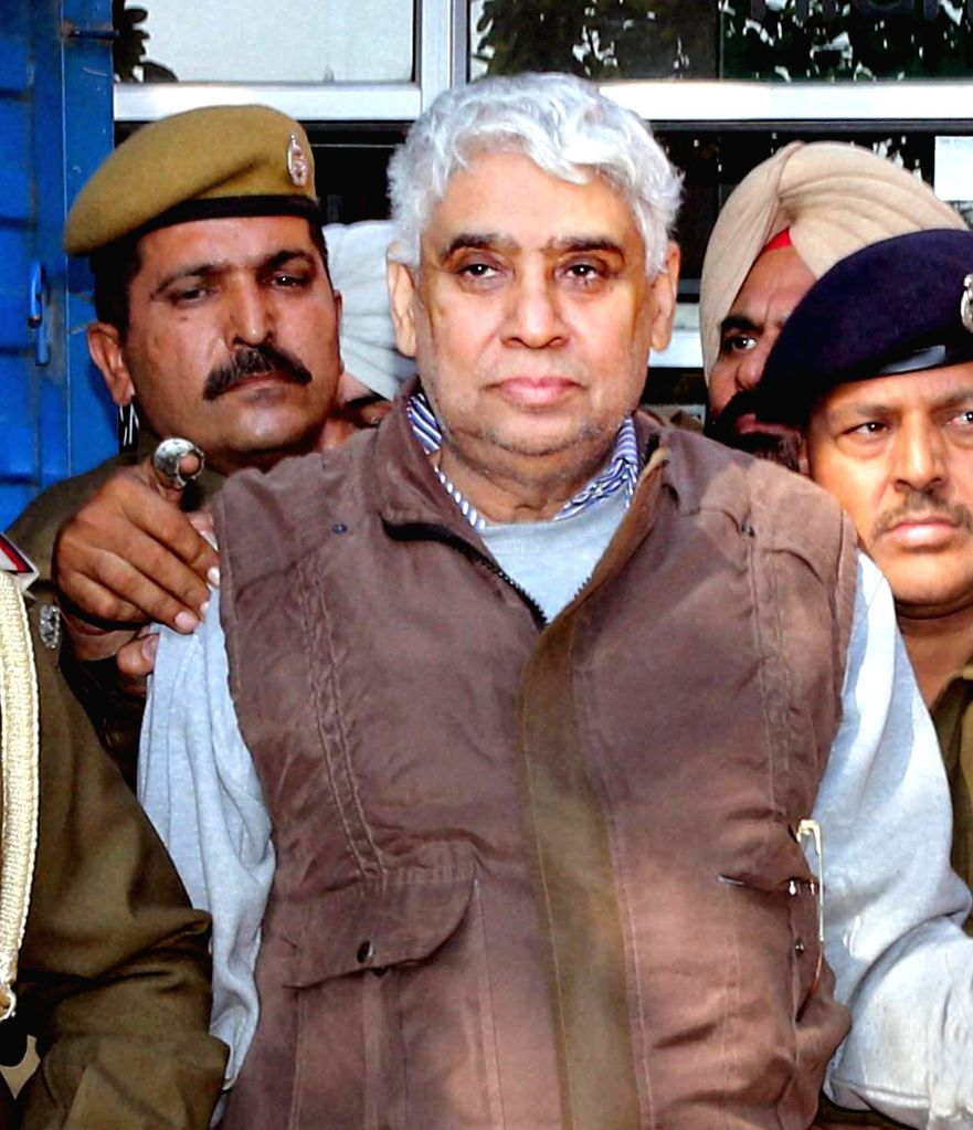 Chandigarh : Controversial sect leader Rampal being taken to be produced at a Chandigarh court on Nov 28, 2014.
