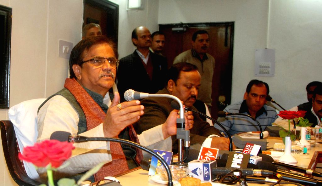 Haryana Agriculture Minister  O.P Dhankar addresses during a press conference in Chandigarh, on Dec 11, 2014.