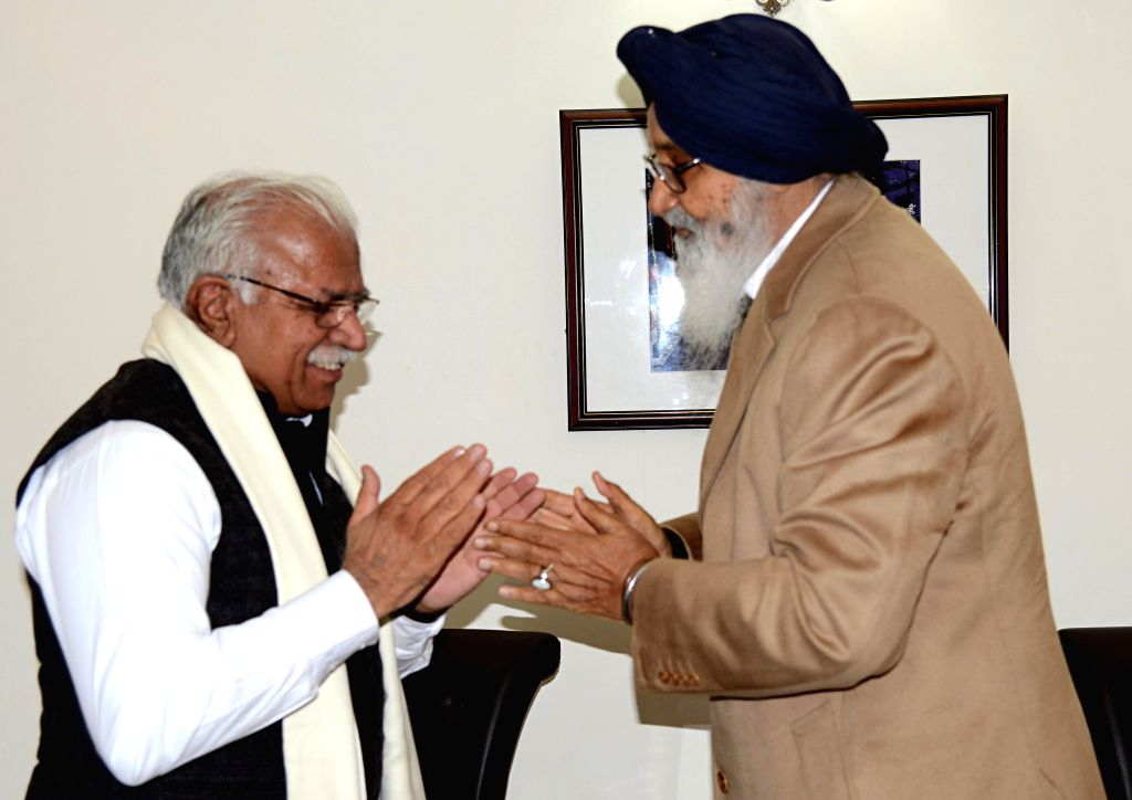 Haryana Chief Minister Manohar Lal Khattar and Punjab Chief Minister  Parkash Singh Badal during a meeting regarding pollution in Ghaggar river in Chandigarh, on Dec 18, 2014.