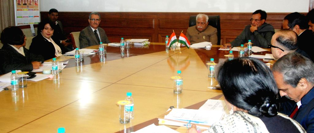 Haryana Chief Minister Manohar Lal Khattar reviews  the working of Labour and Employment Department in Chandigarh on Jan 6, 2015. Also seen Haryana Finance Minister Capt. Abhimanyu. - Manohar Lal Khattar
