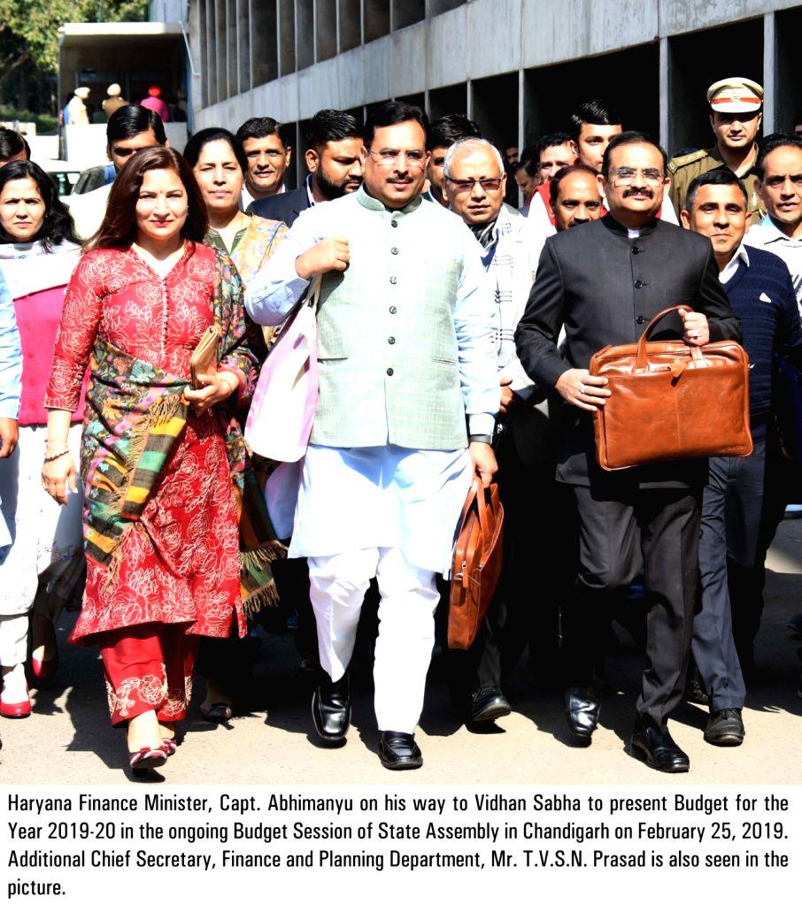 Chandigarh: Haryana Finance Minister Abhimanyu along with Additional Chief Secretary, Finance and Planning TVSN Prasad proceeding to present the state budget 2019 at Haryana Legislative Assembly, in Chandigarh, on Feb 25, 2019. (Photo: IANS) - Abhimanyu