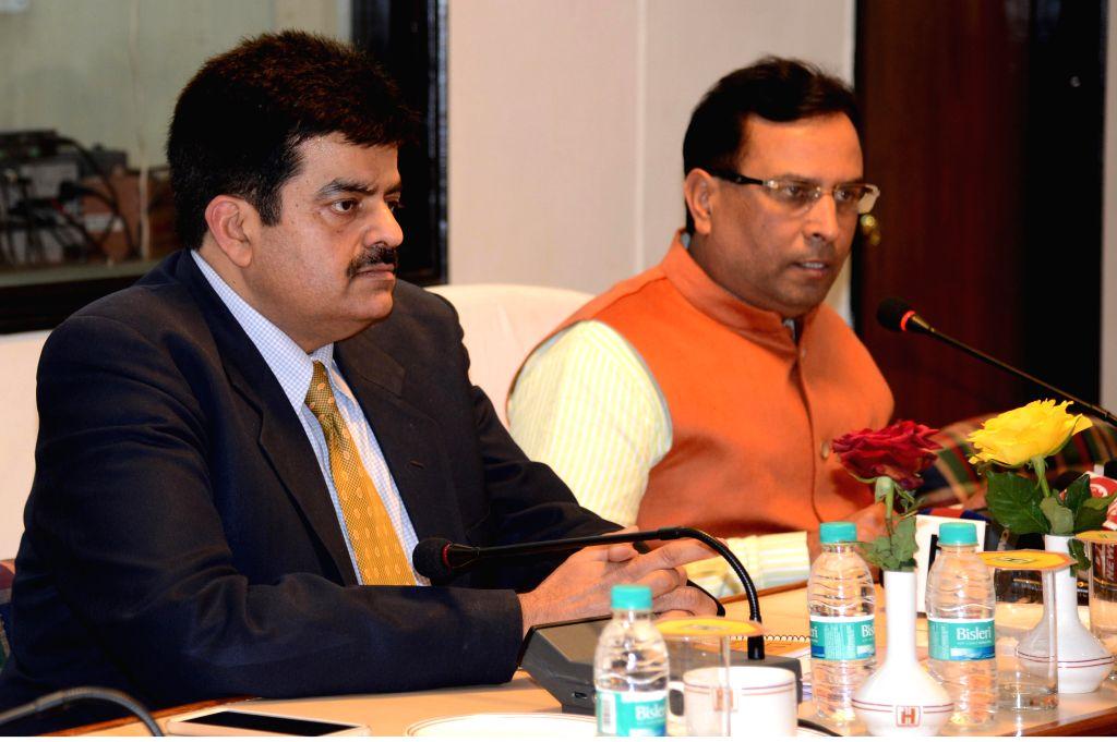 Haryana Finance Minister Capt. Abhimanyu addressing media persons at Chandigarh on Jan. 30, 2015. - Capt