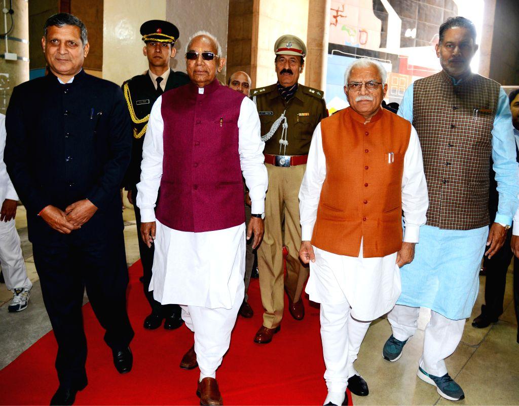 Haryana Governor Kaptan Singh Solanki, Haryana Governor Manohar Lal Khattar, Haryana speaker Kanwar Pal Gujjar, and Haryana Tourism Minister Ram Bilas Sharma arrive at the Haryana ... - Kanwar Pal Gujjar, Kaptan Singh Solanki, Manohar Lal Khattar and Bilas Sharma