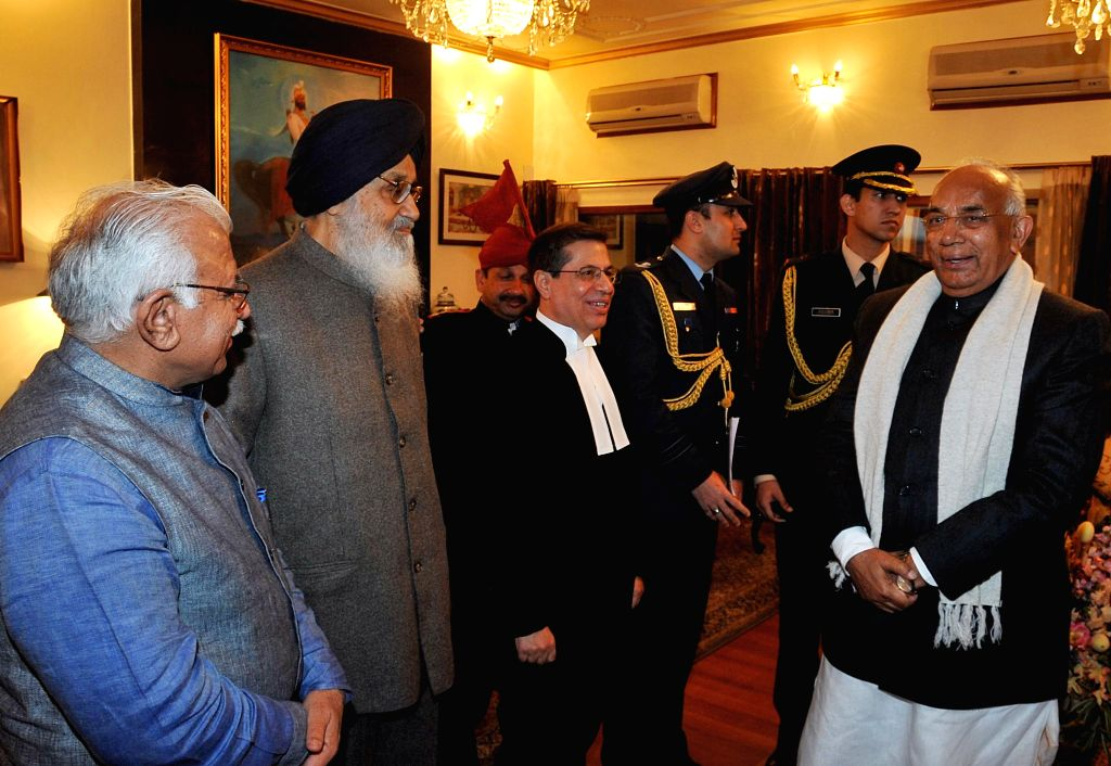 Haryana Governor Prof. Kaptan Singh Solanki, who assumed additional charge as the Governor of Punjab with Punjab Chief Minister Parkash Singh Badal and Haryana Chief Minister Manohar Lal . - Parkash Singh Badal, Kaptan Singh Solanki and Manohar Lal Khattar