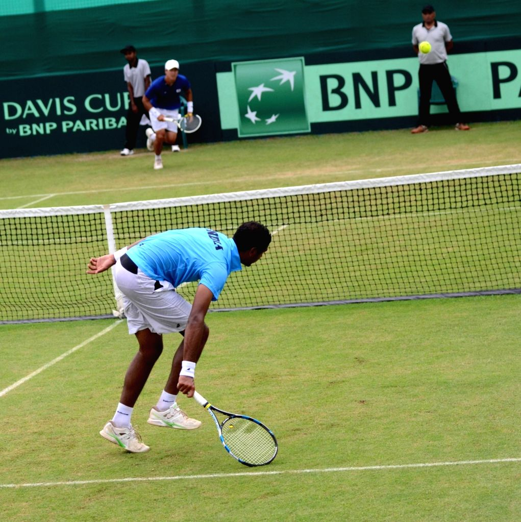 Chandigarh: India's Ram Kumar in action against Korea's Yong-Kyu Lim during Asia/Oceania Group I 2nd Round of Davis Cup in Chandigarh on July 17, 2016. - Kumar