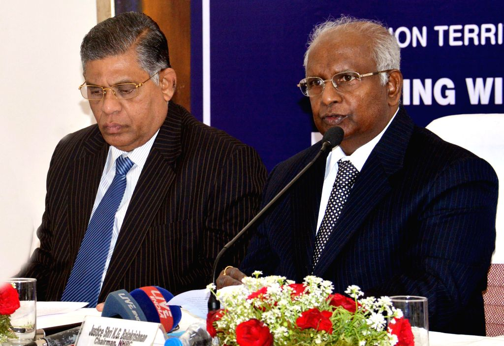 National Human Rights Commission chairperson Justice K.G. Balakrishnan addresses press in Chandigarh on Nov 28, 2014. Also seen NHRC members Justice D. Murugesen.