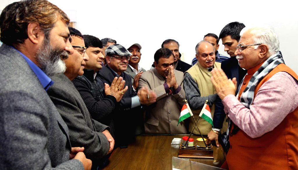 People greet Haryana Chief Minister Manohar Lal Khattar on Makar Sankranti in Chandigarh on Jan 14, 2015. - Manohar Lal Khattar