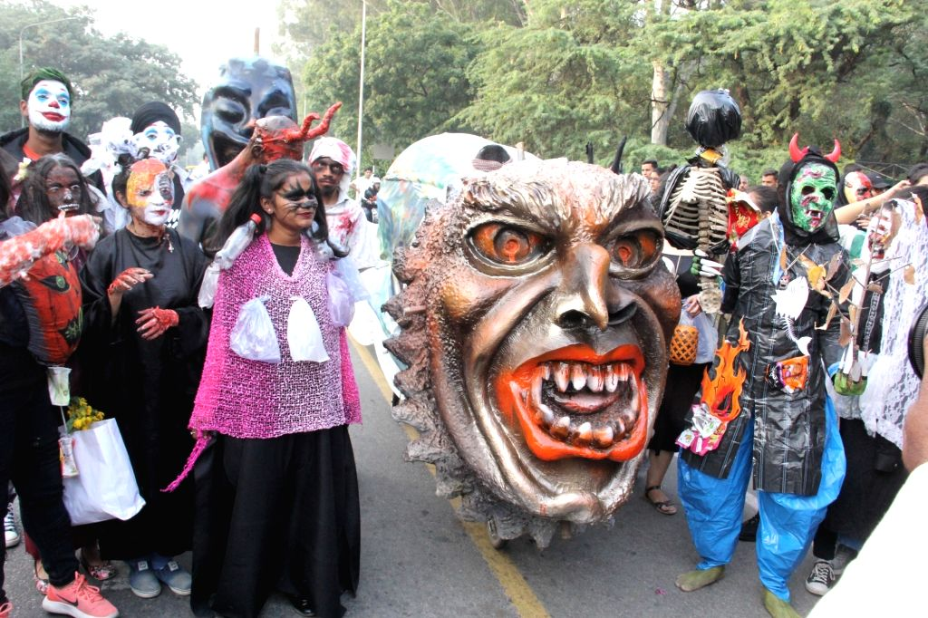 Chandigarh: People participate in a Halloween rally on theme 'The Harrows of Plastic' aimed at sensitizing people on minimising use of single-use plastic, in Chandigarh on Oct 31, 2019. (Photo: IANS)