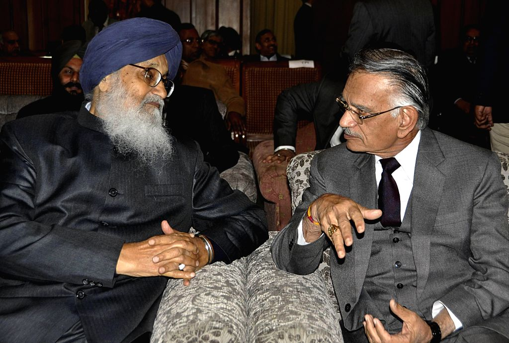 Punjab Chief Minister Parkash Singh Badal with outgoing Chandigarh administrator and Governor of Punjab Shivraj V Patil during the latters farewell function in Chandigarh, on Jan 21, .. - Parkash Singh Badal